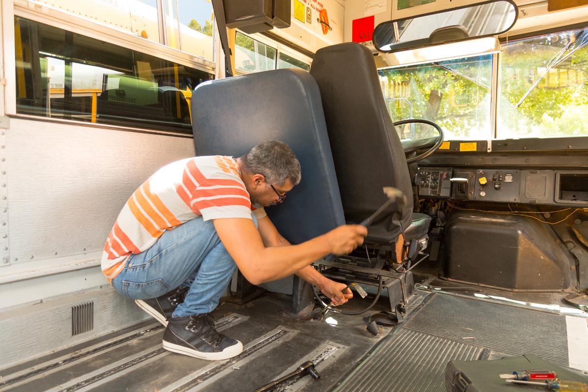 Removing stubborn school bus seats