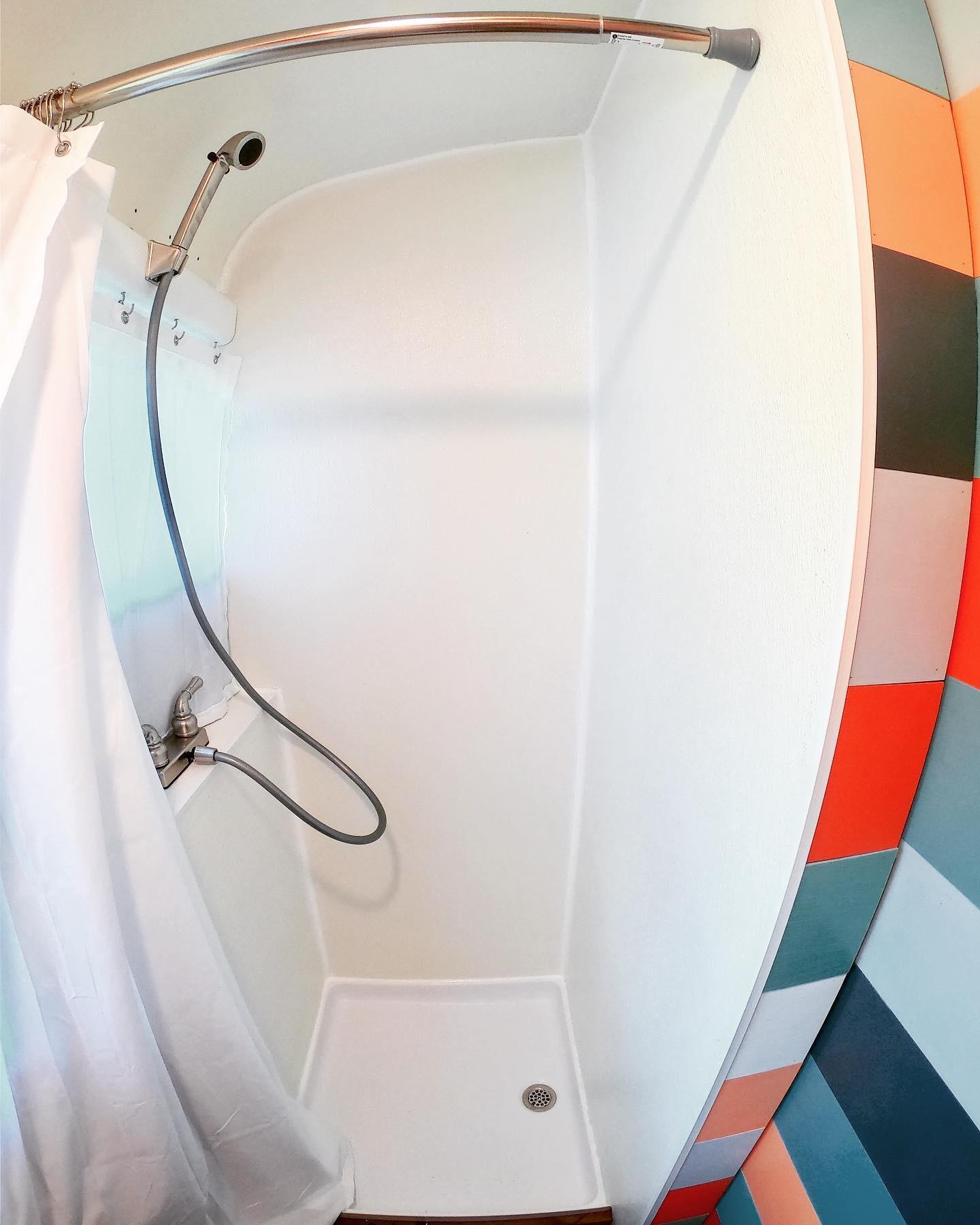 School bus tiny house bathroom shower