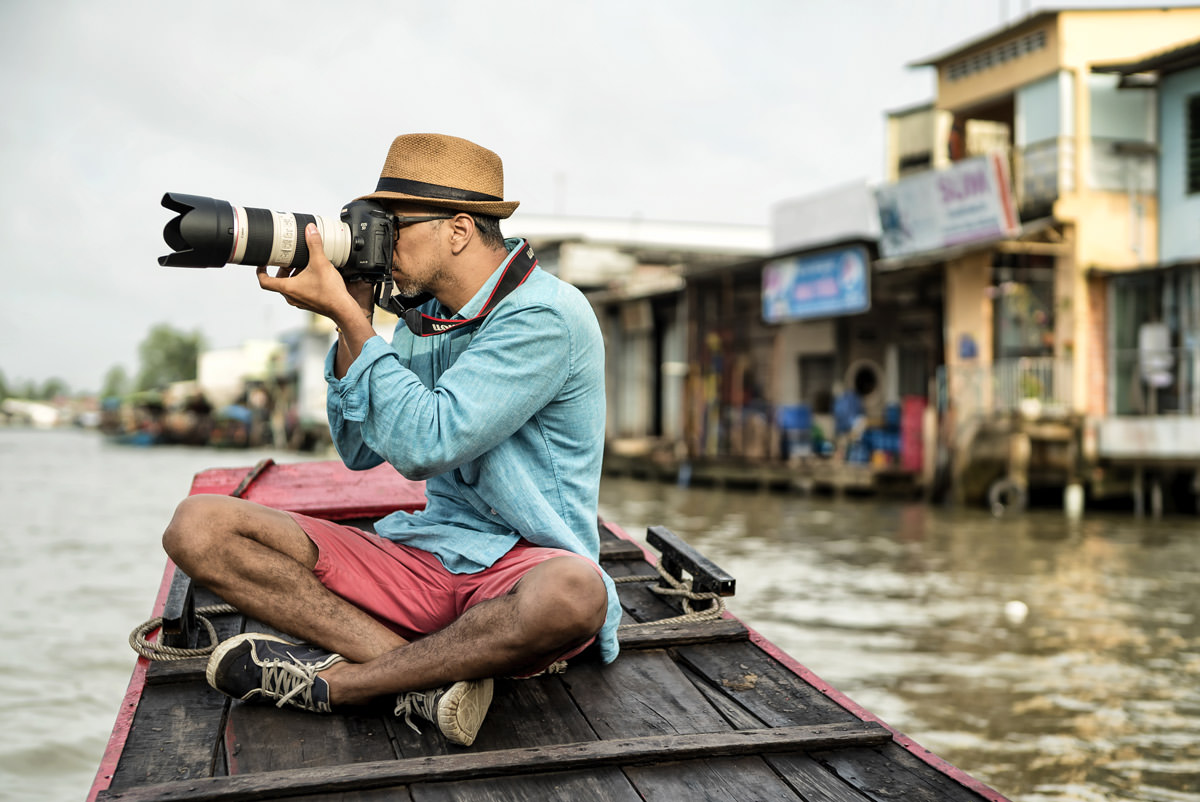 Jose-Taking-Photo-Telephoto-Lens-Boat-Vietnam